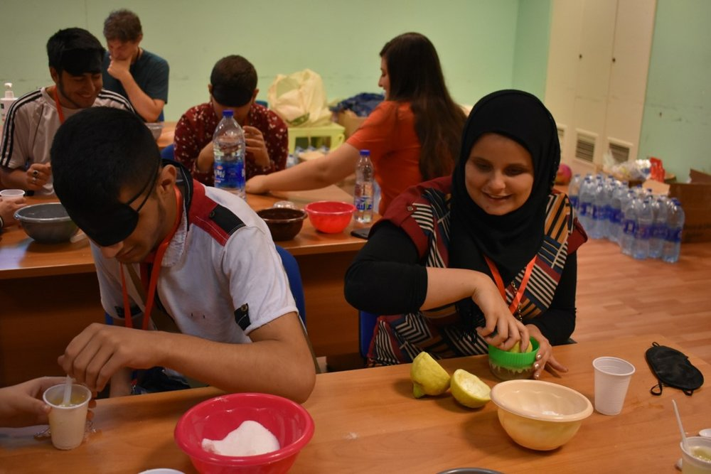 Visually impaired participants preparing carbonated lemonade during science class