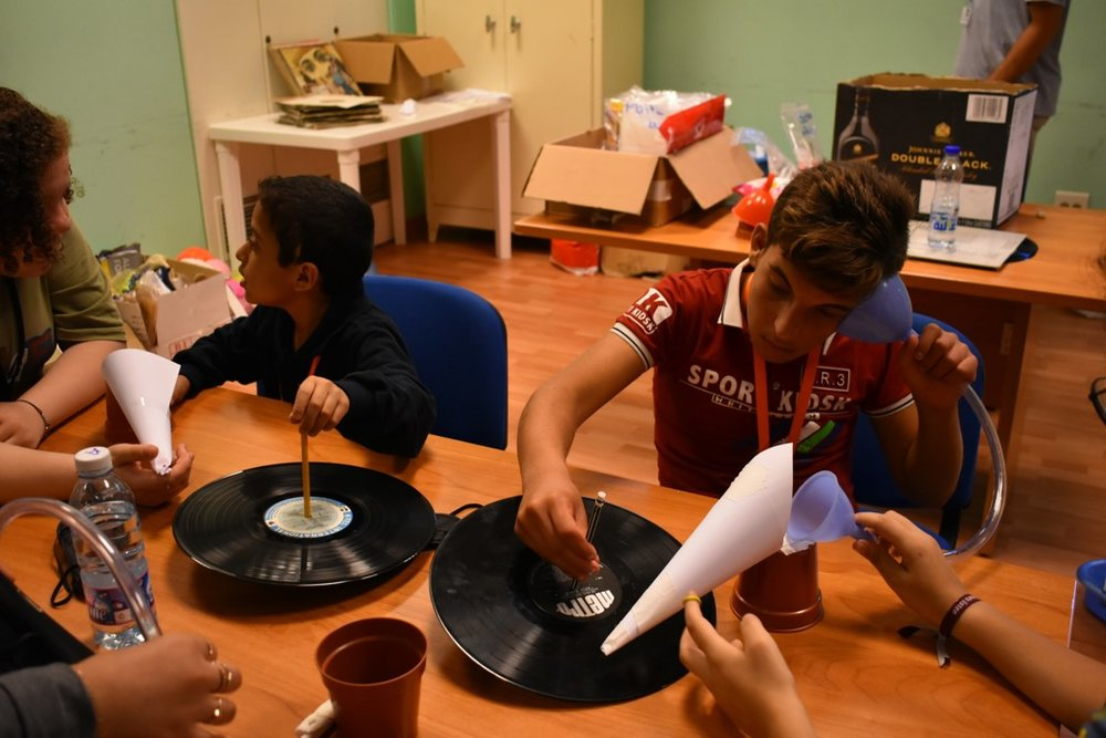 Visually impaired participants listening to their own record players during science class