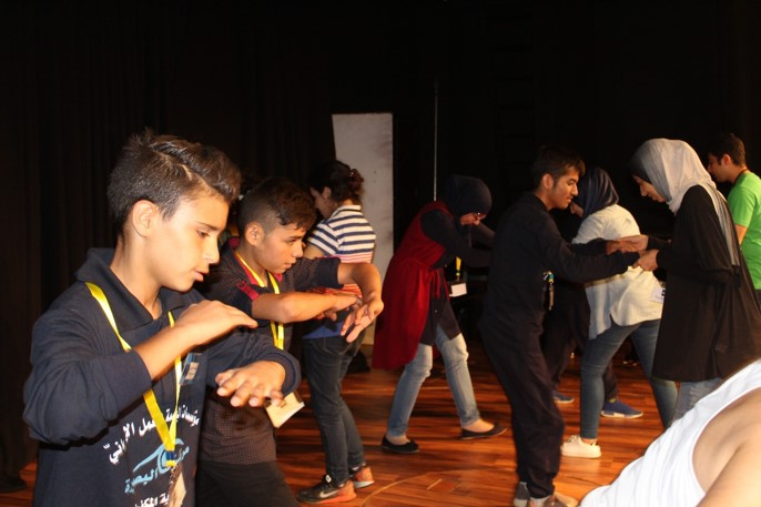 Visually impaired participants and volunteers learning capoeira moves