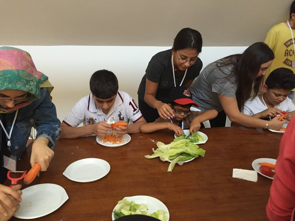 Children practising cutting vegetables