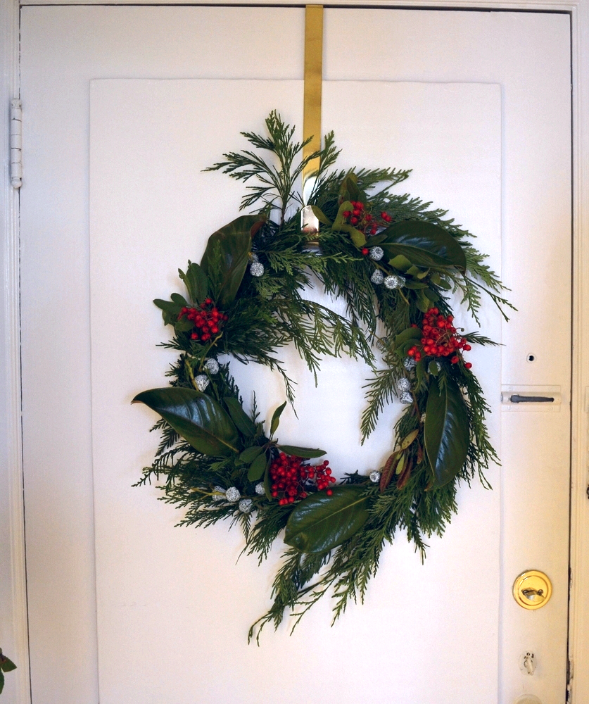 I debated between a wreath and garland at the tree lot. I ended up going with garland. With the extra I decided to make this wreath. I used the spare garland as the base and the other things were leftover from our Thanksgiving table. I really like the free-formed look.