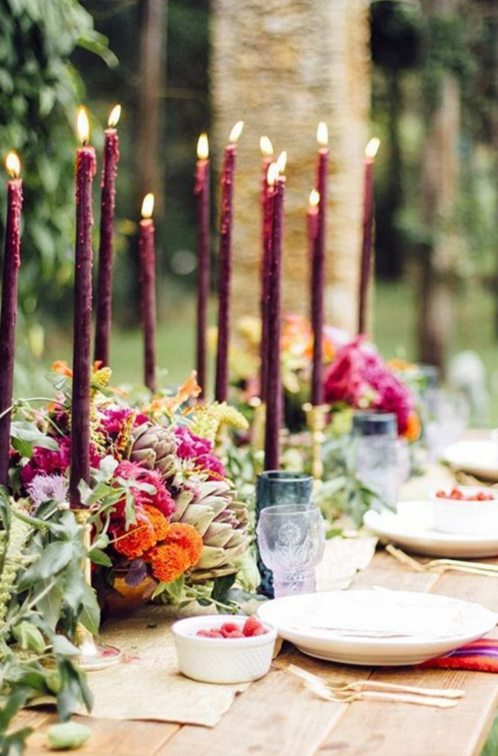 I like the dramatic statement of these purple candles. I think it could be paired with fewer flowers and still make a beautiful table.