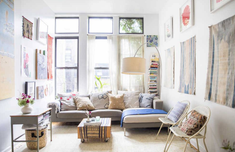 I love how this eclectic room still looks light and fresh. Image via  Domino .