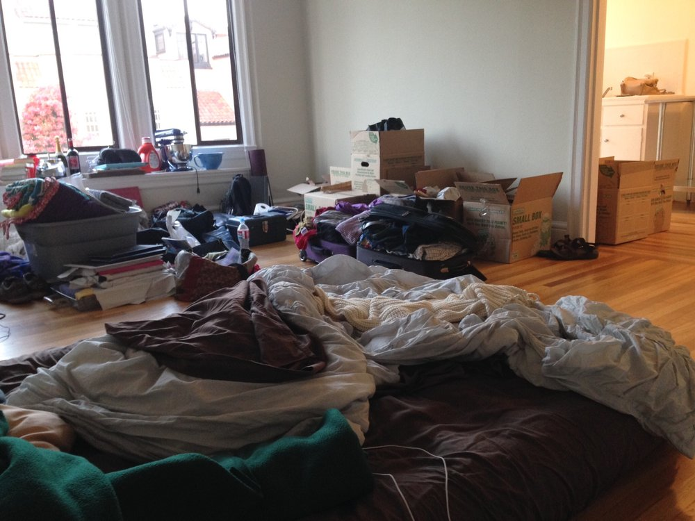 A never-shared-anywhere-else glimpse at the first day of unpacking in San Francisco. We didn't even have a real bed yet, that's an air mattress!