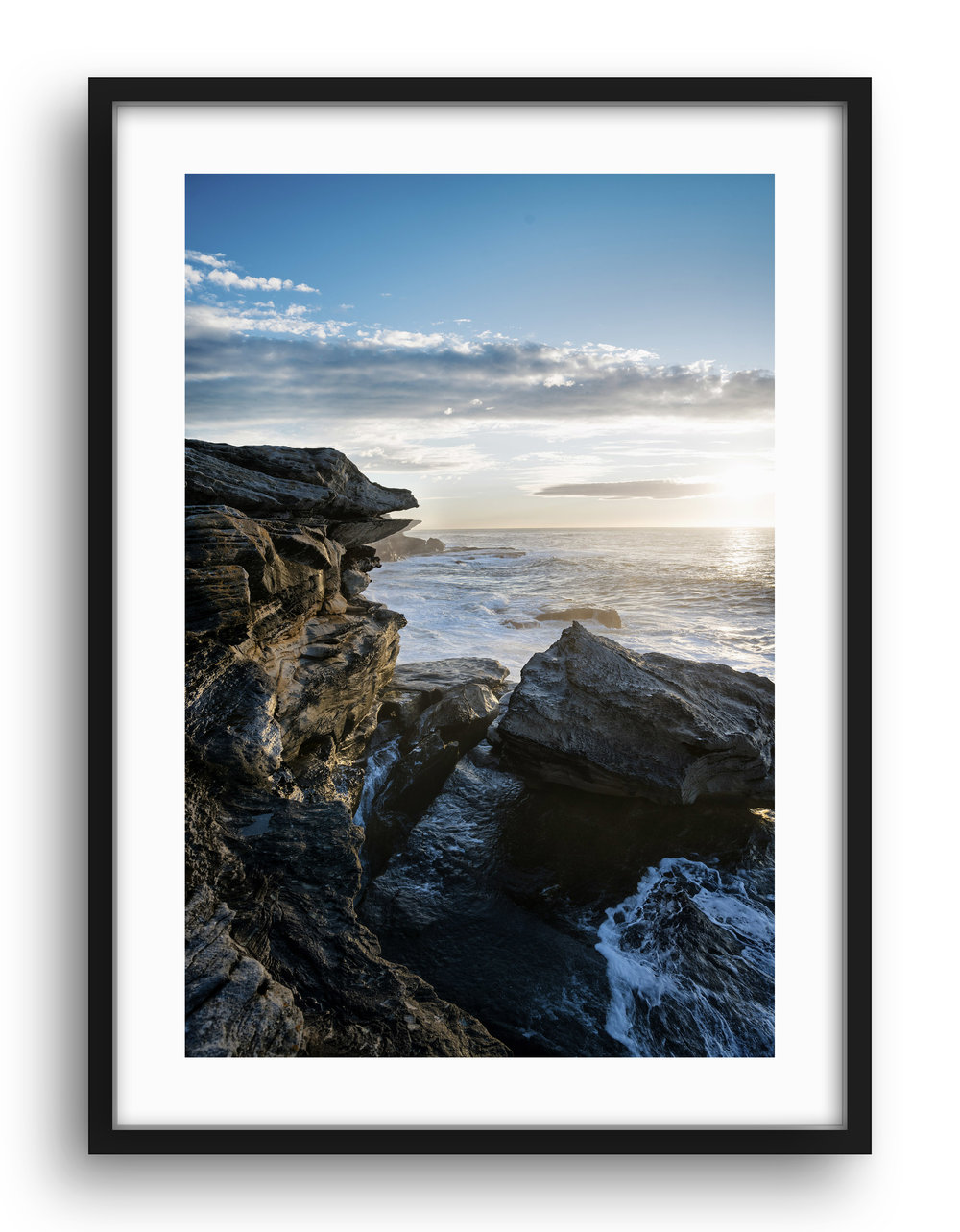 """COAST"" Series This series shot around the Australian coast and focused near my home in Sydney shows the beauty of the fringes of the Australian continent. I'm often drawn to Rock formations that are like a giant sculpture carved by the powers of nature. I love waking up early and getting down to the beach to catch the first light or dawn. Watching the sun come up and the colours radiate across the sky as the light refracts through the earths atmosphere grounds us and gives us a greater understanding of our place within the universe. As the tide rushes in and out and the waves and winds carve the Coast it is nature that dominates. Framed and unframed prints are available from $285."