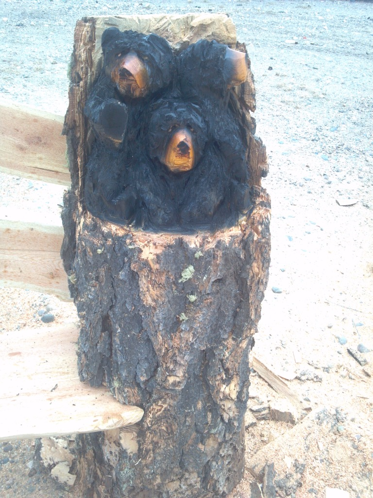 bear-cubs-in-log-chainsaw-carved-bench.jpg