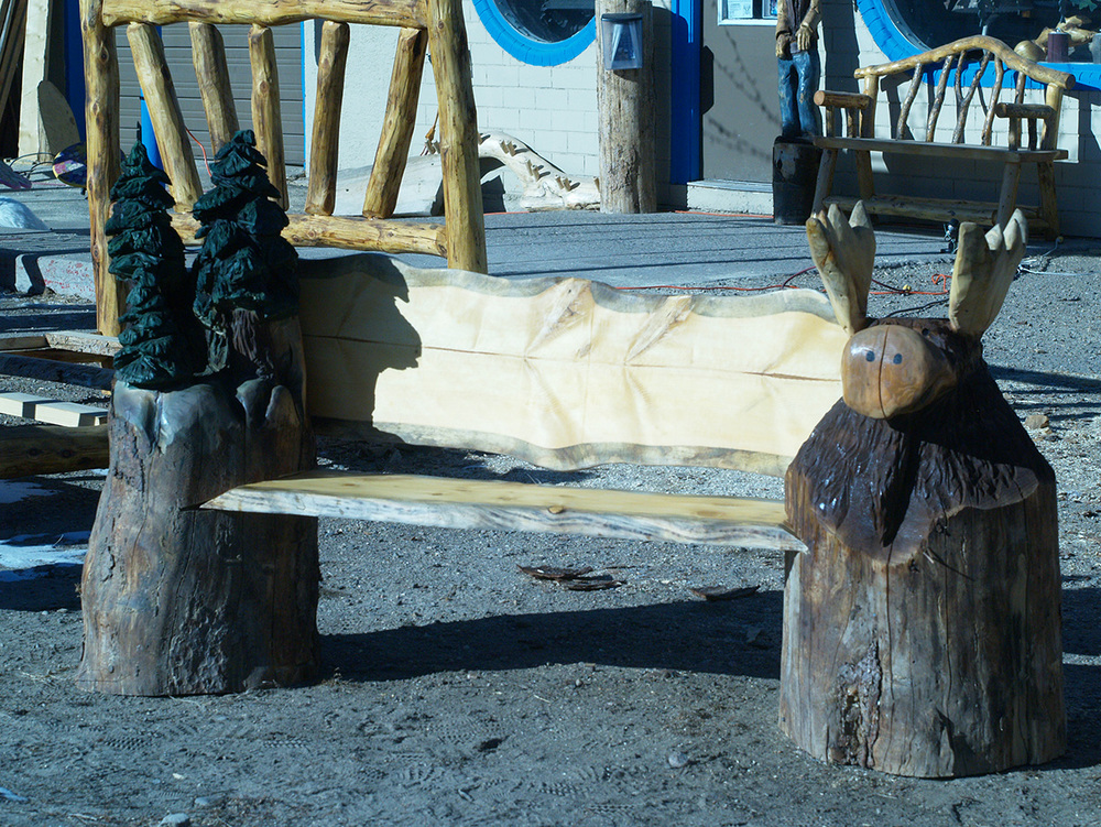 chainsaw-carved-moose-bench-1.jpg