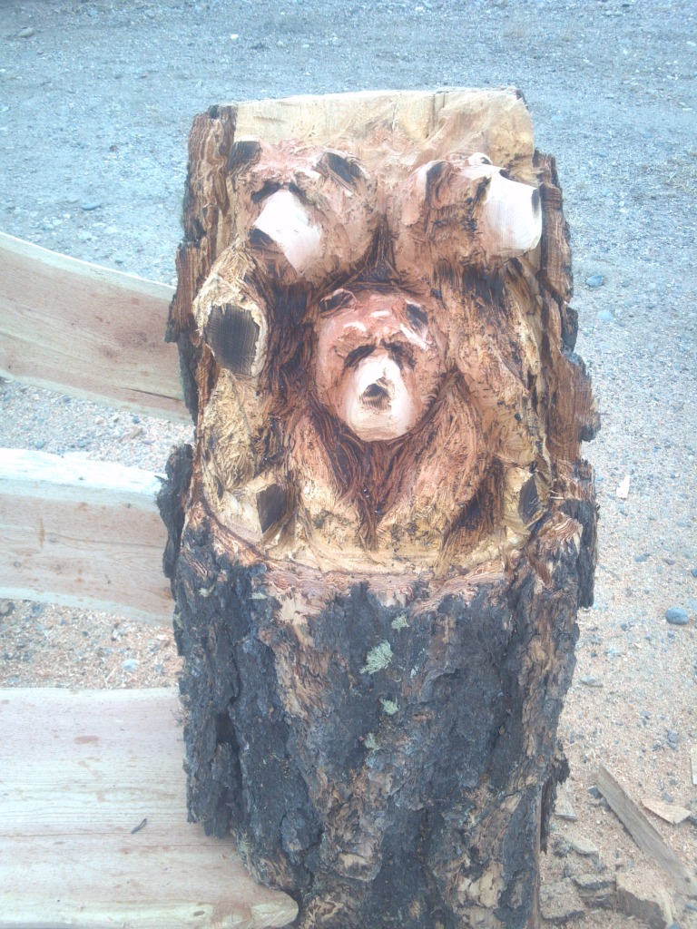 chainsaw-carving-bear-cubs-bench.jpg