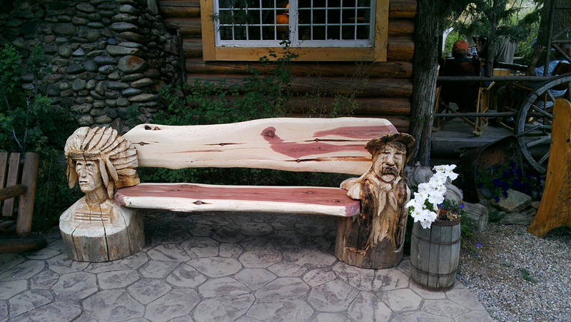 cowboy-and-indian-bench-chainsaw-carving.jpg