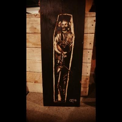 dead outlaw in coffin