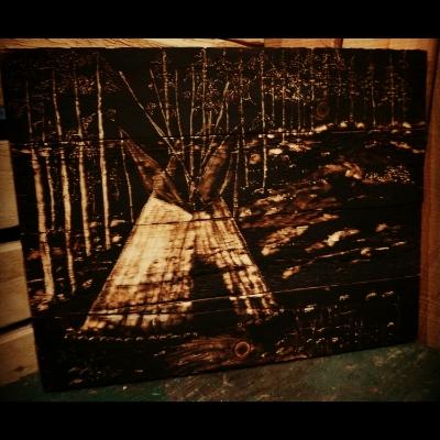 teepee in woods