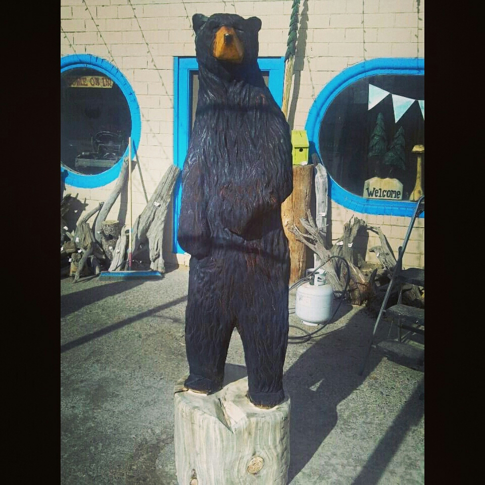 7' bear carving, made while the customer was out hunting