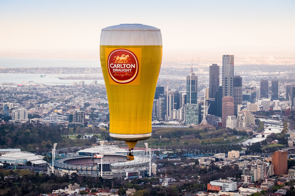 Carlton Draught pot balloon flying over the Melbourne CBD and MCG on the morning of the 2018 AFL Grand Final.