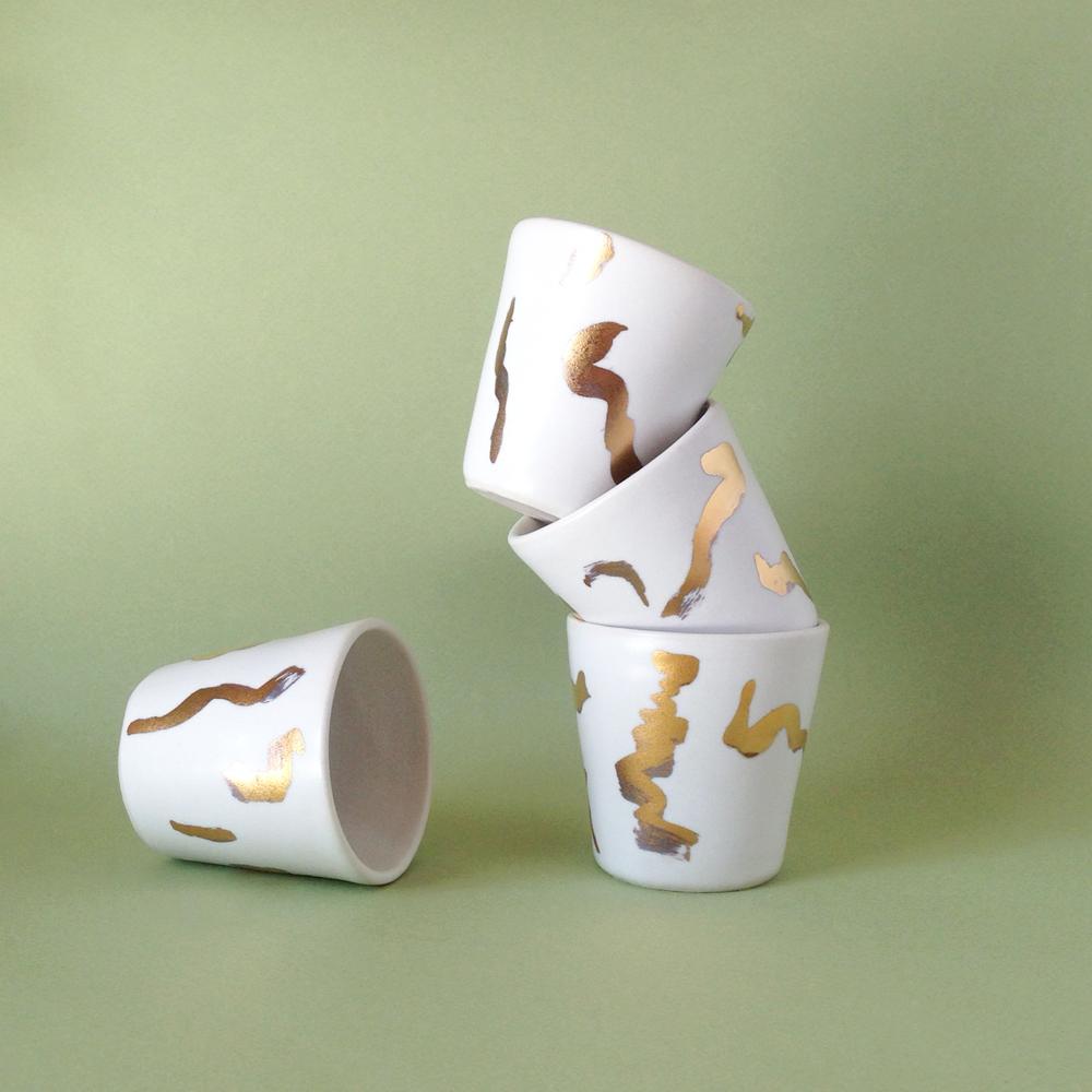 handmade porcelain cup gold lustre falling for florin