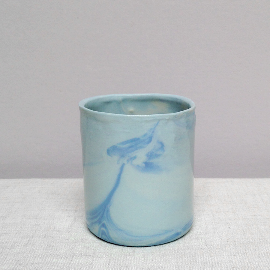 handmade porcelain cup falling for florin