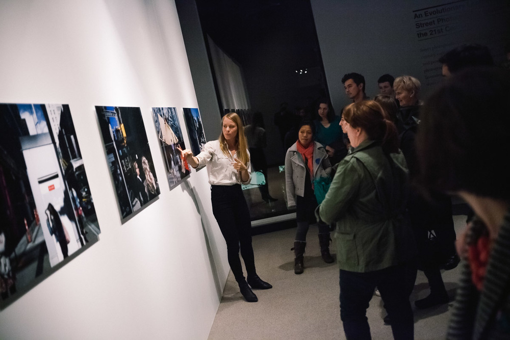 "Curator Katie Huisman presenting We Are All In This Production (2013) at the Museum of Vancouver as part of the inaugural Capture Photography Festival. Photographs were presented as 24 x 36"" prints mounted onto Dibond."