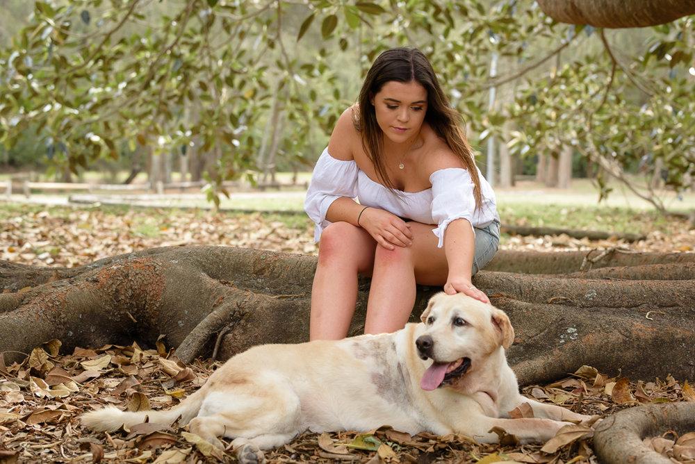 girl patting dog.jpg