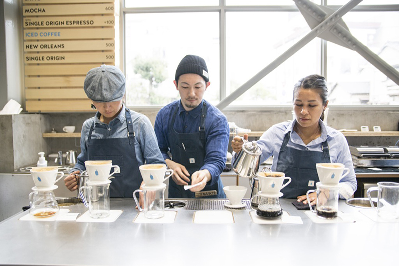 Baristas making coffee