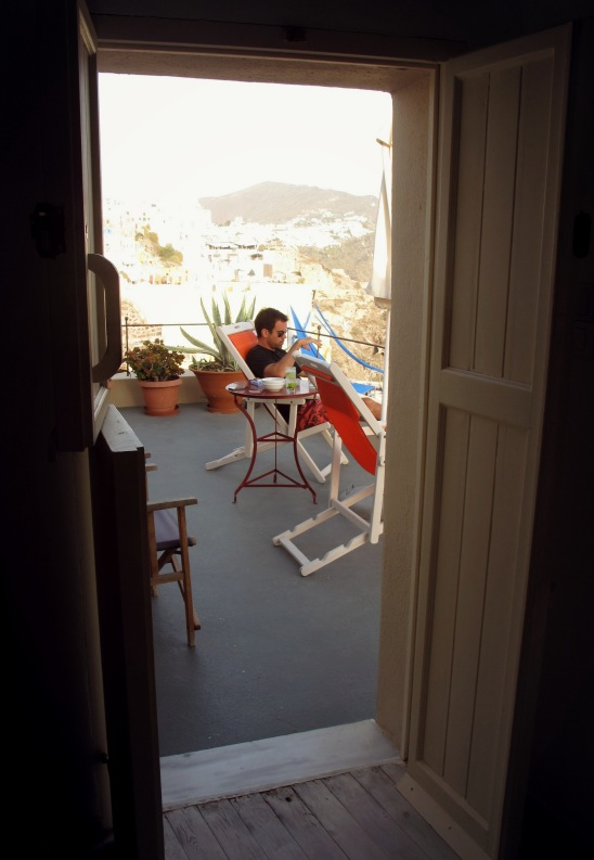 Santorini_reu on balcony_through door.jpg