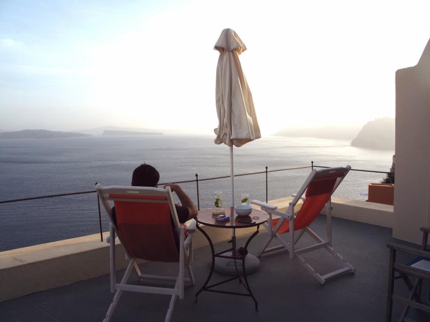Santorini_reu on balcony_view of ocean.jpg