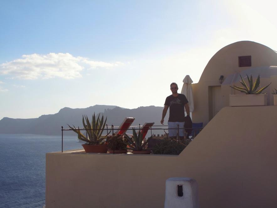 Santorini_Reu on balcony_from distance.jpg