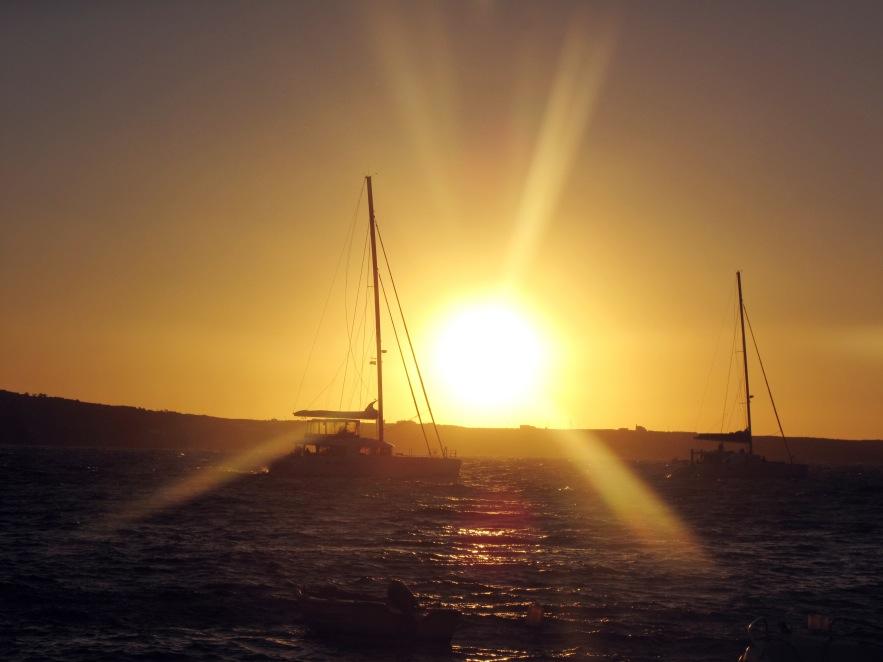 Santorini_amouldi bay_boats passing at sunset.jpg