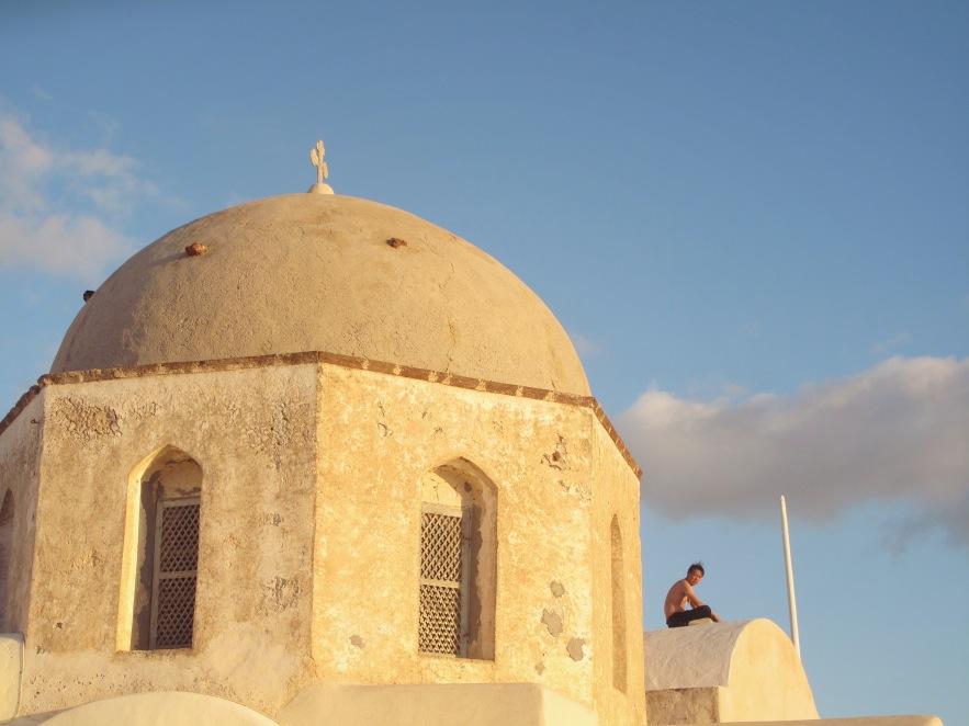 Santorini_man on dome_wideshot.jpg