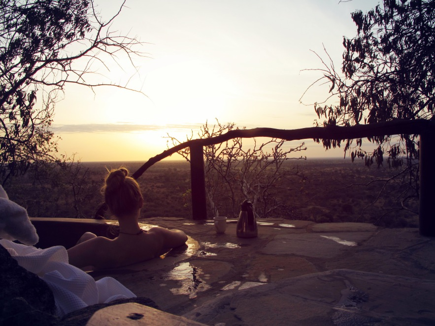 Watching the sunrise from our outdoor tub before heading out on safari.