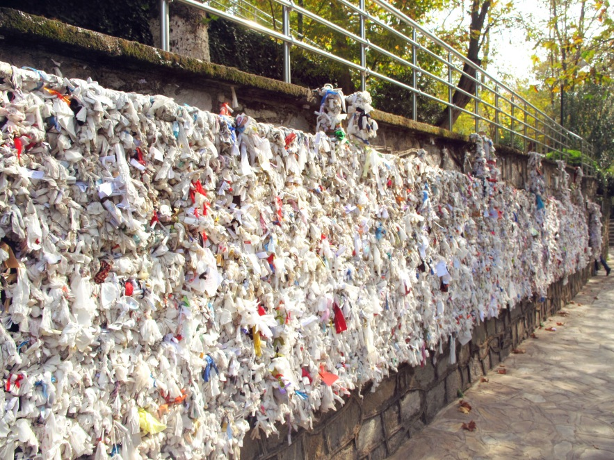 incredible wall of notes and prayers to mary