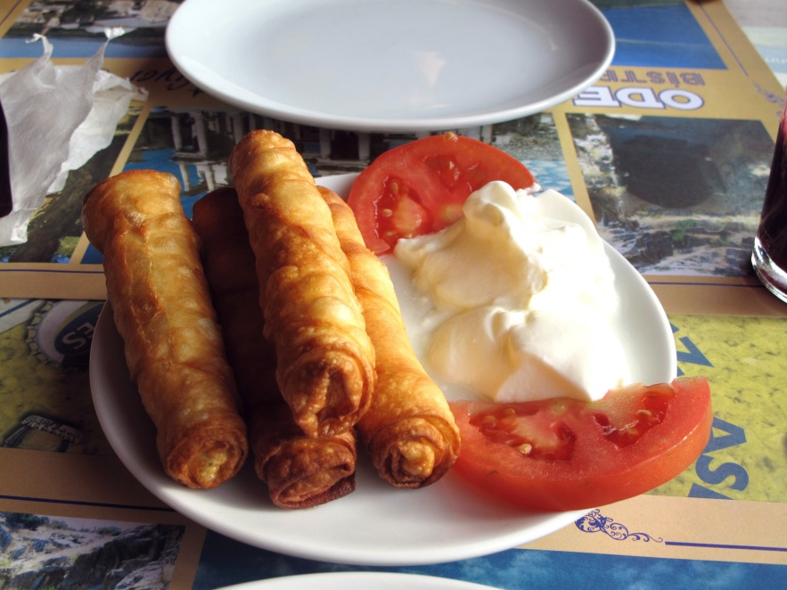 These are'Boreks', my favorite turkish food. They are basicallycigar shaped rolls filled with cheese and parsley then deep fried...so savory and delicious!