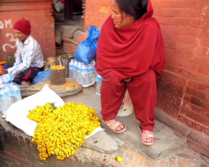 Kat_Pashupatinath Temple_lady in red with yellow flowers.JPG