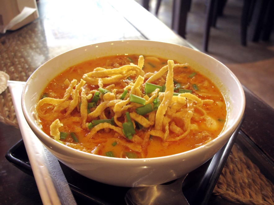 Tasting our first Khaosoi - a traditional coconut milk based noodle dish
