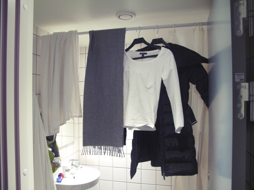 The bathroom of a traveleralso doubles as a laundry/drying room