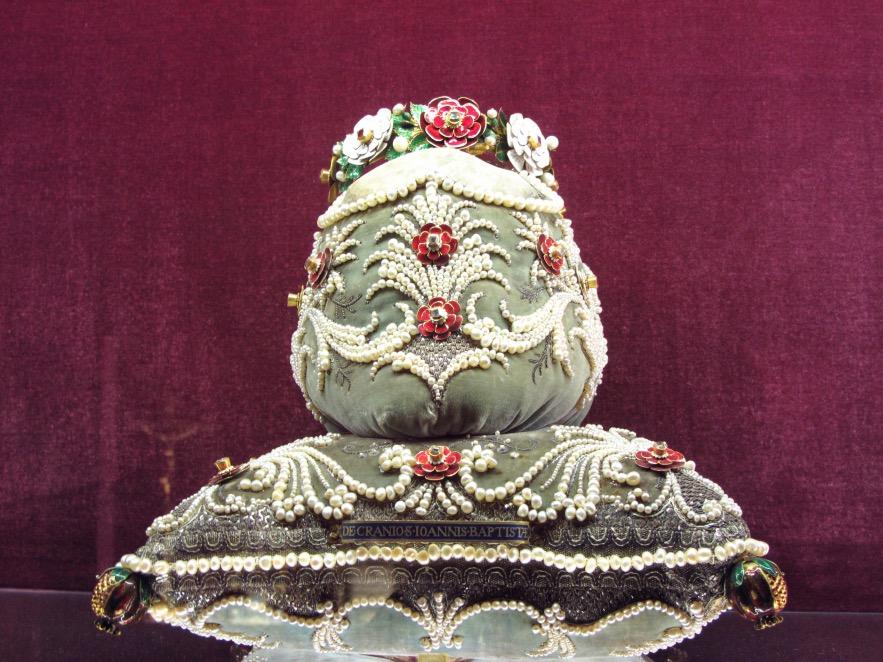 Velvet and pearl covered skulls of royalty.