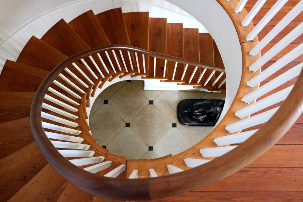 The beautiful 3 story stair case.