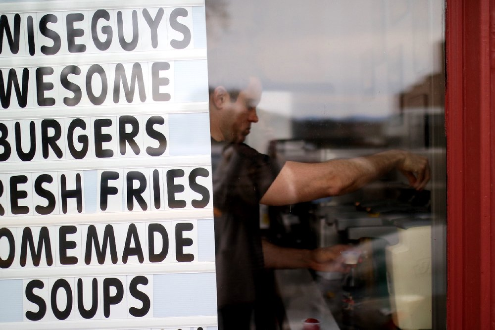 Getting burgers at the local 'wise guys' joint.