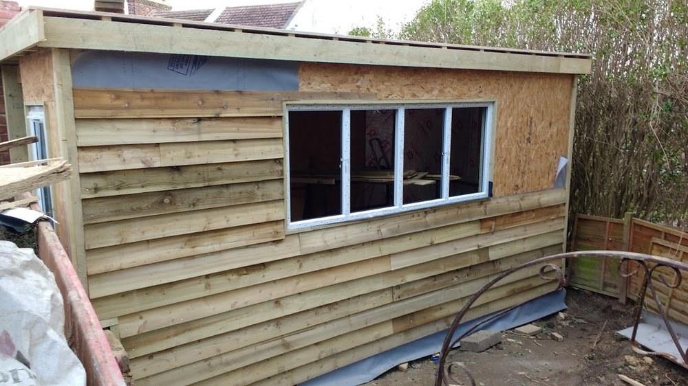 Waterproof membrane and weatherboarding go up