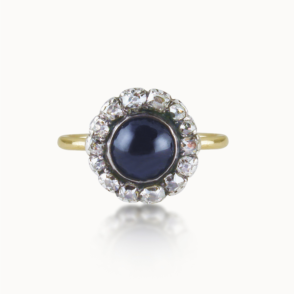 ANTIQUE CABOCHON SAPPHIRE AND DIAMOND CLUSTER RING