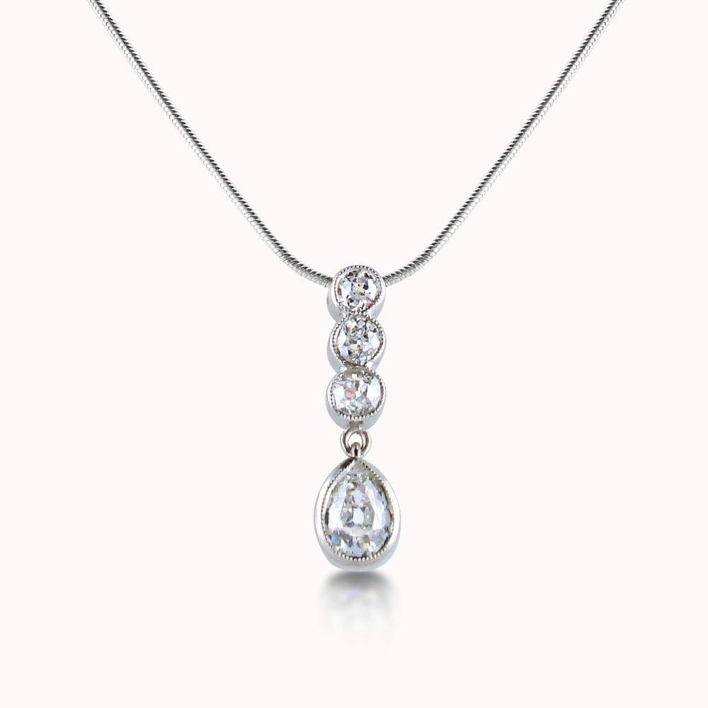 FOUR-STONE DIAMOND PENDANT