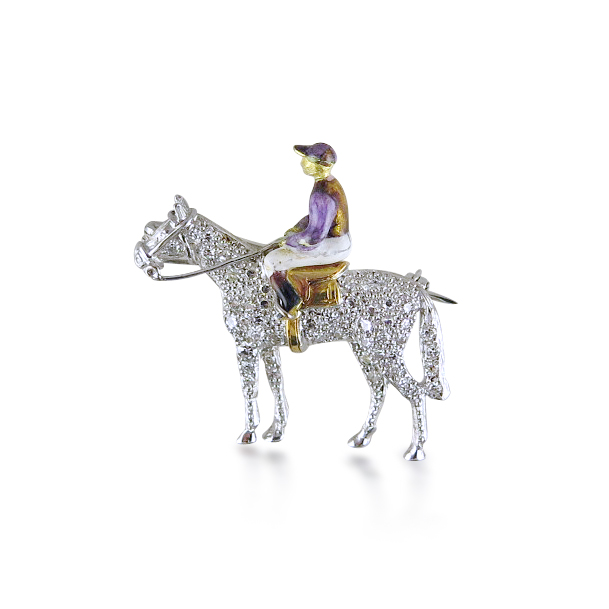 Diamond and enamel horse and jockey brooch,  the horse pavé-set with single-cut diamonds, the jockey's silks in polychrome enamel