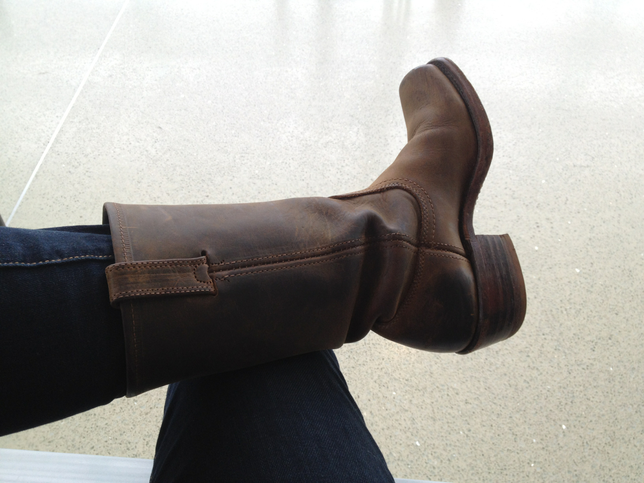 At the airport early (headed back down to London for a brief stop to go to a production of Judas Kiss up in Cambridge). Thinking about my traveling boots. Got into the habit of wearing these in Africa, where they protected me from snakes. Now I often wear them to travel because they slip off for security, and work in all weather. Plus they make me much taller, which sometimes is a nice feeling in a new place.