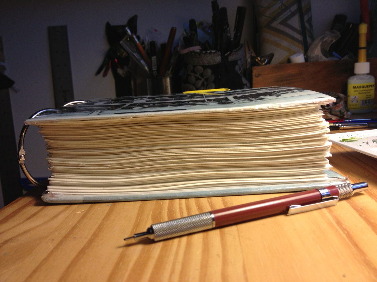 "I finished ""Displacement,"" but then I was like ""I'll add a bunch more pages to this, because I'm ridiculous."" So it's back to being not done yet. I think it might be because I dread having to scan it all. If I just draw it forever, I'll never have to start scanning it. 116/130 pgs done."