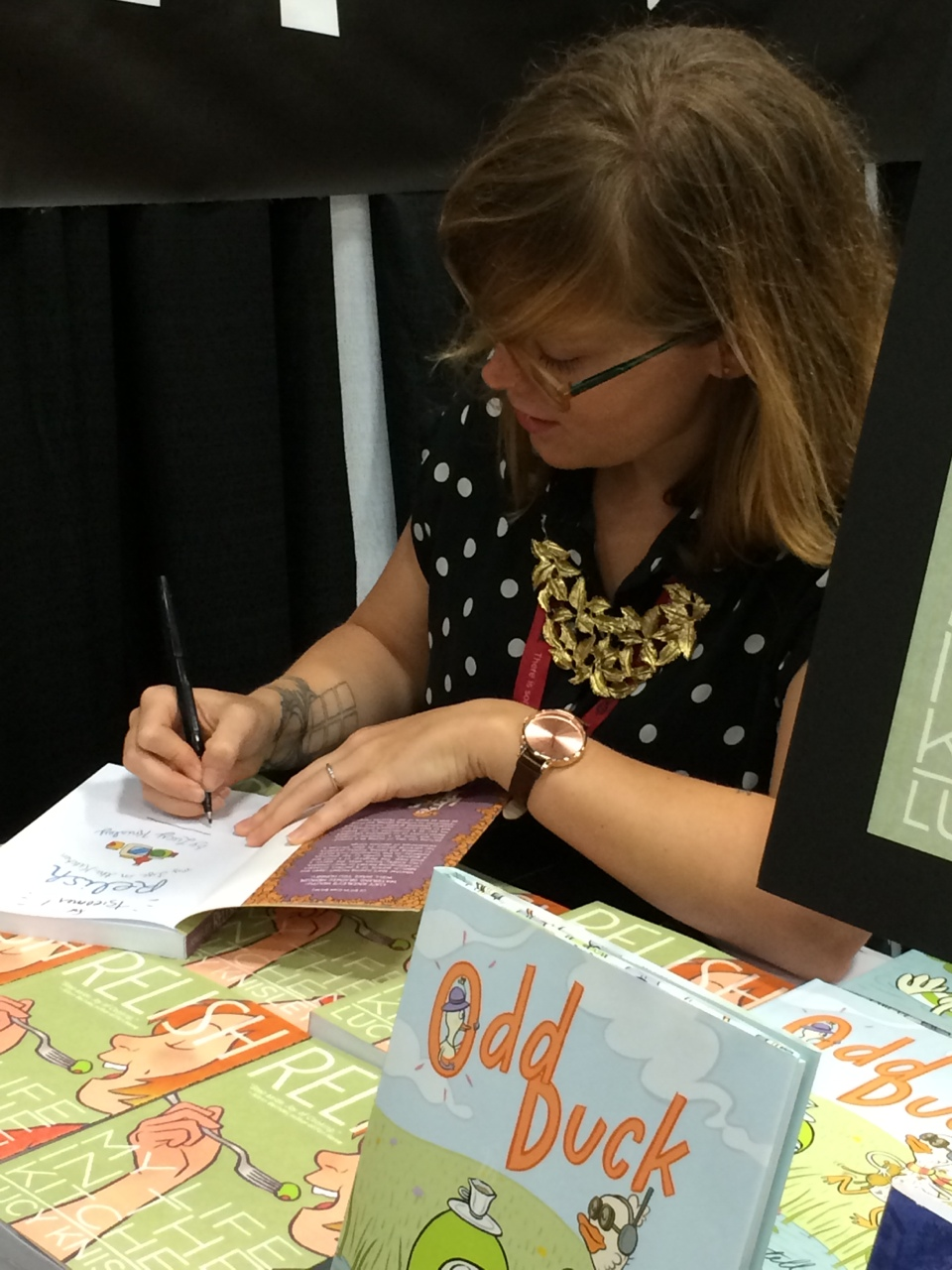 firstsecondbooks: Lucy Knisley signs her wonderful graphic novel RELISH at San Diego Comic-Con! Sold out of both of my books on Saturday!
