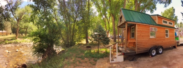 Our tiny home parked riverside at Riverview RV Park