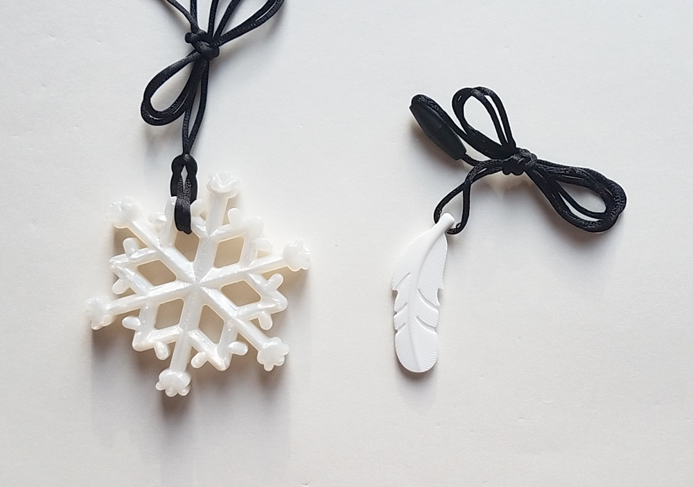 From left: White snowflake, white feather.