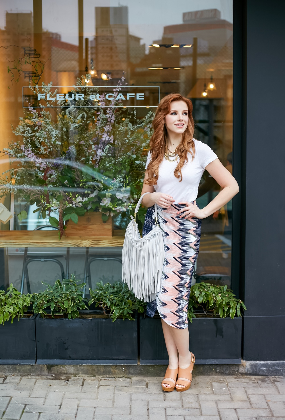 Redhead wearing midi skirt and fringe bag