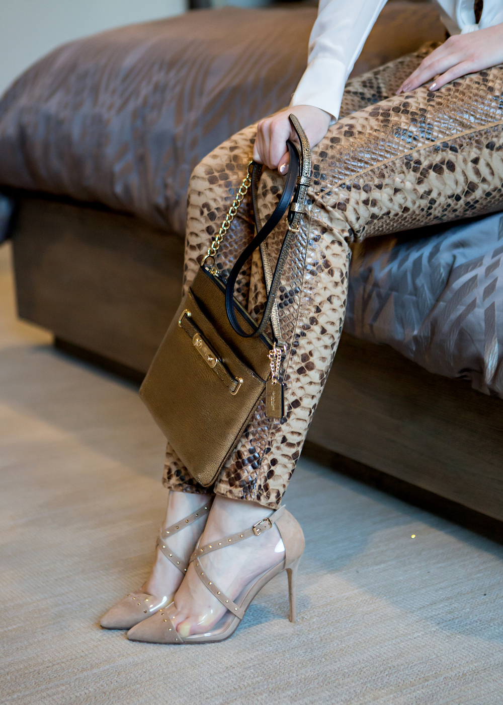 snake skin pants with gold bag