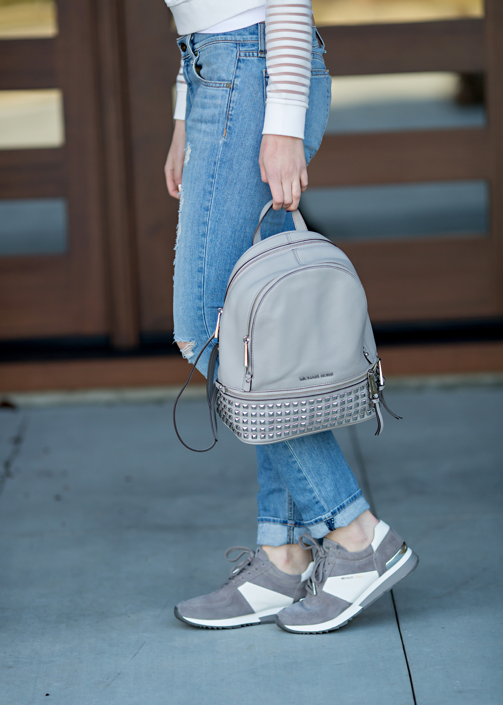 Michael Kors Stud Backpack and tennis shoes casual fashion