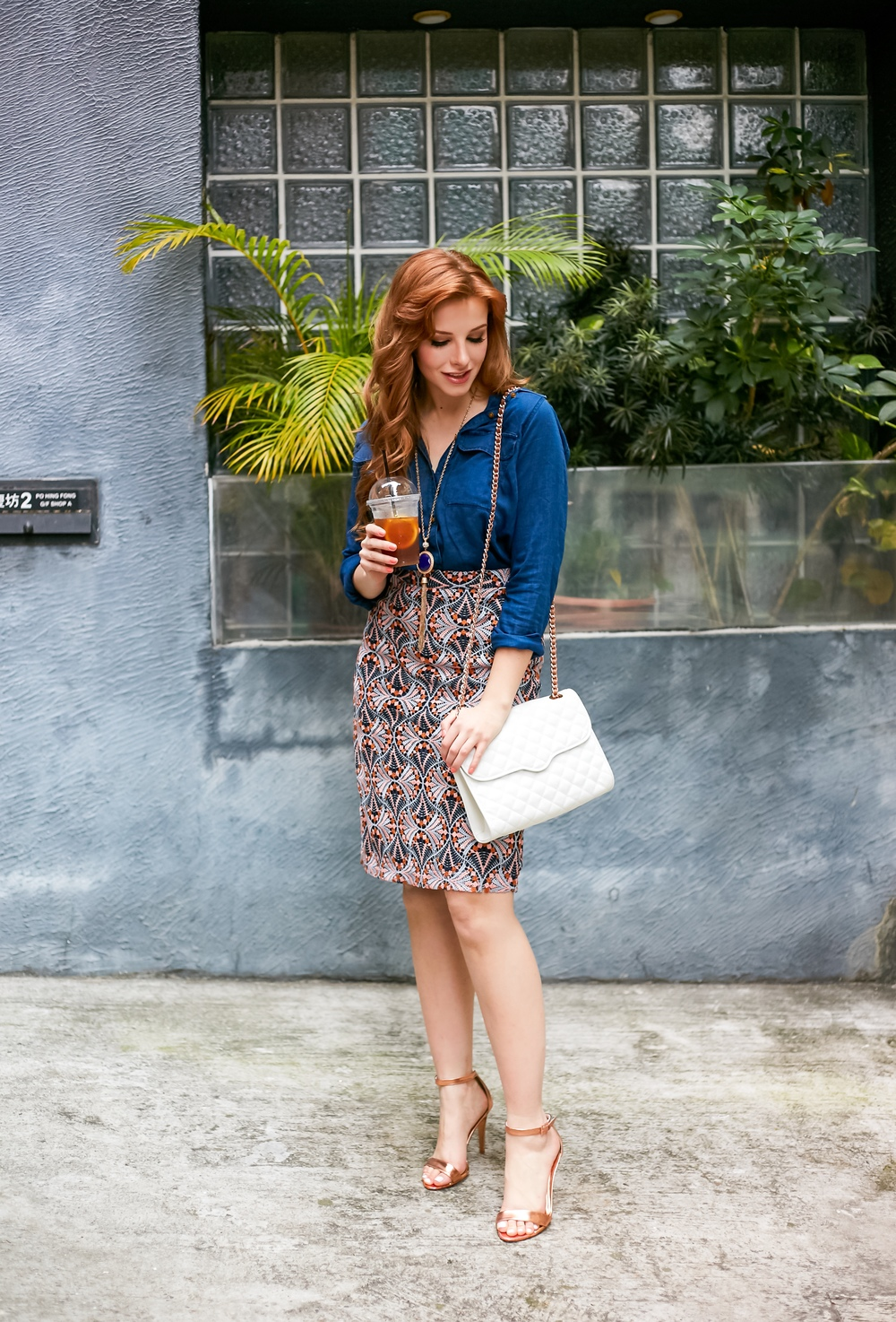 redhead fashion wearing rose gold and denim