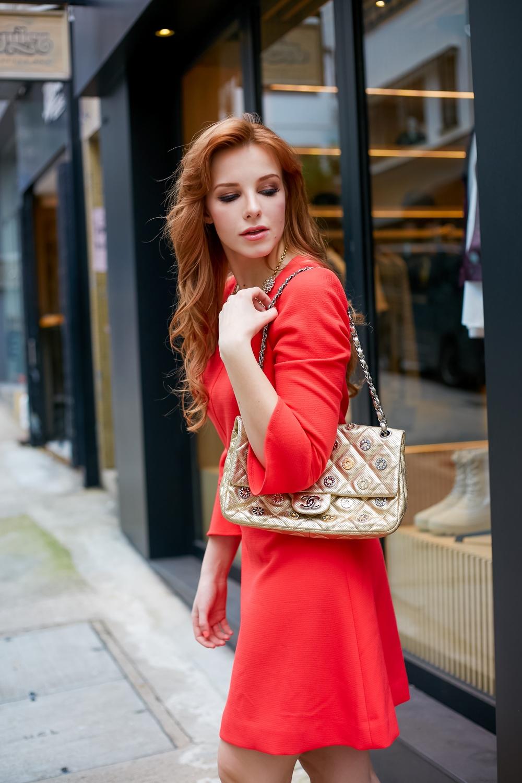 redhead wearing chanel bag j. crew dress